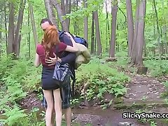Redhead French gf blows cock in the woods
