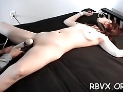 Ballgagged and unable to move, this wench gets stimulated