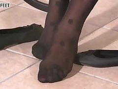 Schoolgirl in moonless dotted stockings plays with her feet