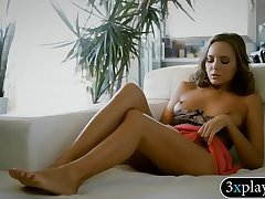 Horny brunette mollycoddle finger fucks her pussy on the couch