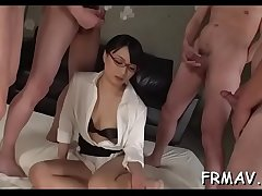 Charming japanese playgirl tames a thick pecker with blowjob